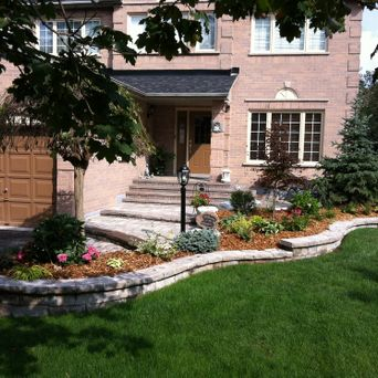 After - New steps, new walkway, new shrubs, new garden planter. Call us for YOUR new front yard facelift.