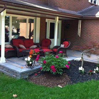 We can rejuvenate your old concrete porch by installing a retainer around the perimeter, adding new paver stones on top, with new gardens