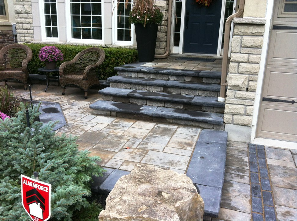 We installed new interlock paver stones directly on top of the existing concrete front porch.