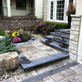 Part of our landscape design incorporates contrasting colours to accent the interlock banding and step treads.