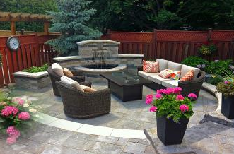 This water feature within the backdrop wall is the focal point while entertaining on your patio.