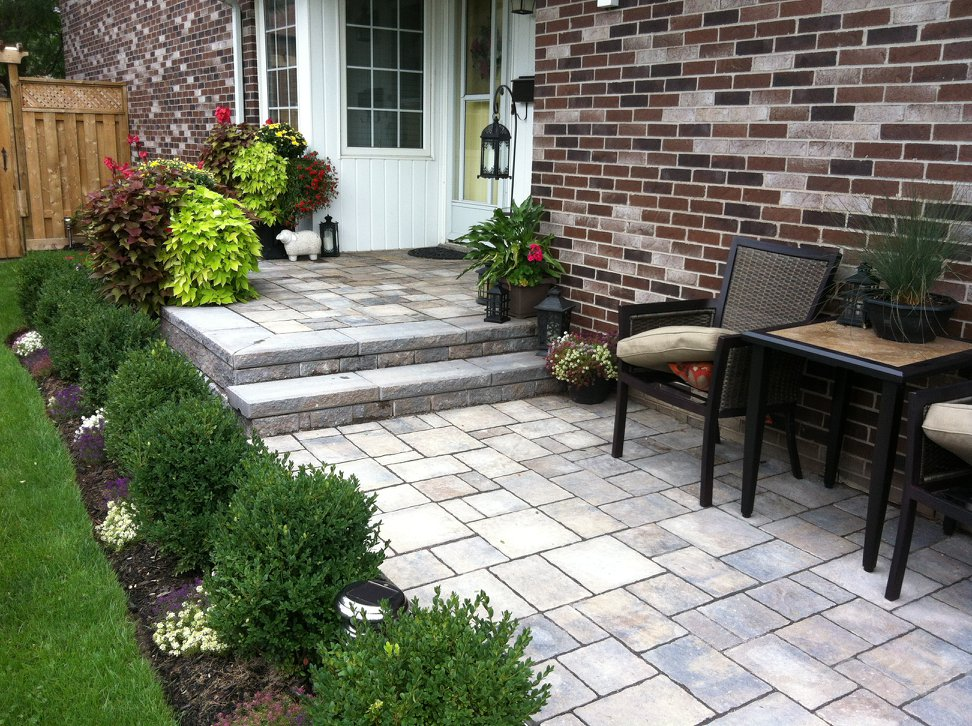 The old steps and walkway were replaced with decorative paver stones.