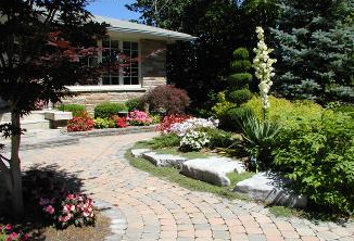 A successful mix of hardscape materials with colourful planting selections.
