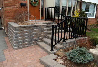 Stairs, planter and decorative railing safely enhance this elevated front entrance.