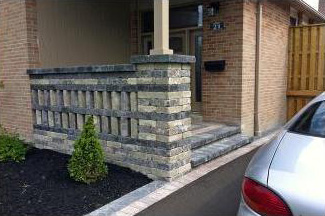 This decorative stone wall gave our customers the privacy they wanted on their front porch.