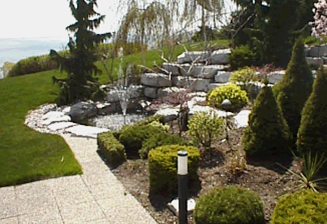 Slopes make an ideal location for waterfalls and rockery gardens.