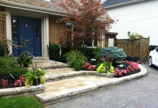 Artistic steps and garden retainers with colourful plant selections give your front entrance pizzazz.