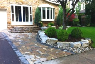 Driveway expansion, rockery garden border, and curved steps leading to front door.
