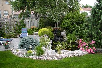 Plants, trees, patio, pond, and colourful plants. How peaceful – how tranquil.