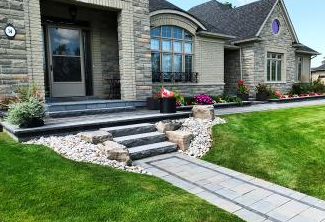 Natural stone steps blend well with this contemporary front entrance design layout.