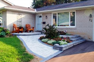 Accessibility concerns can be addressed with your front entrance landscape designs.