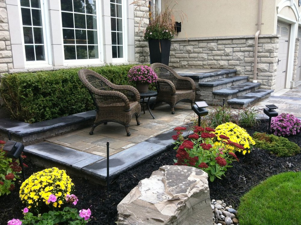 New steps, new sitting patio, new gardens, a complete outdoor facelift