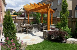 Our design for this tight backyard includes a patio, pillars, seating wall and overhead pergola.