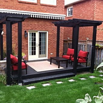 Backyard deck with pergola sitting area. A perfect spot to relax on those lazy summer days.