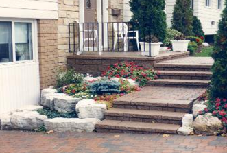 Rockery stones can be used with retaining walls for an attractive combination.