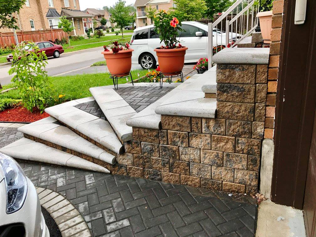 The old concrete side of the existing porch can be disguised with new stone products.
