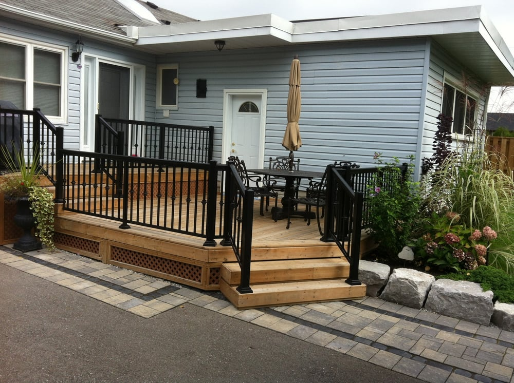 A new deck, railing, walkway and rockery garden allows you to enjoy those summer days.
