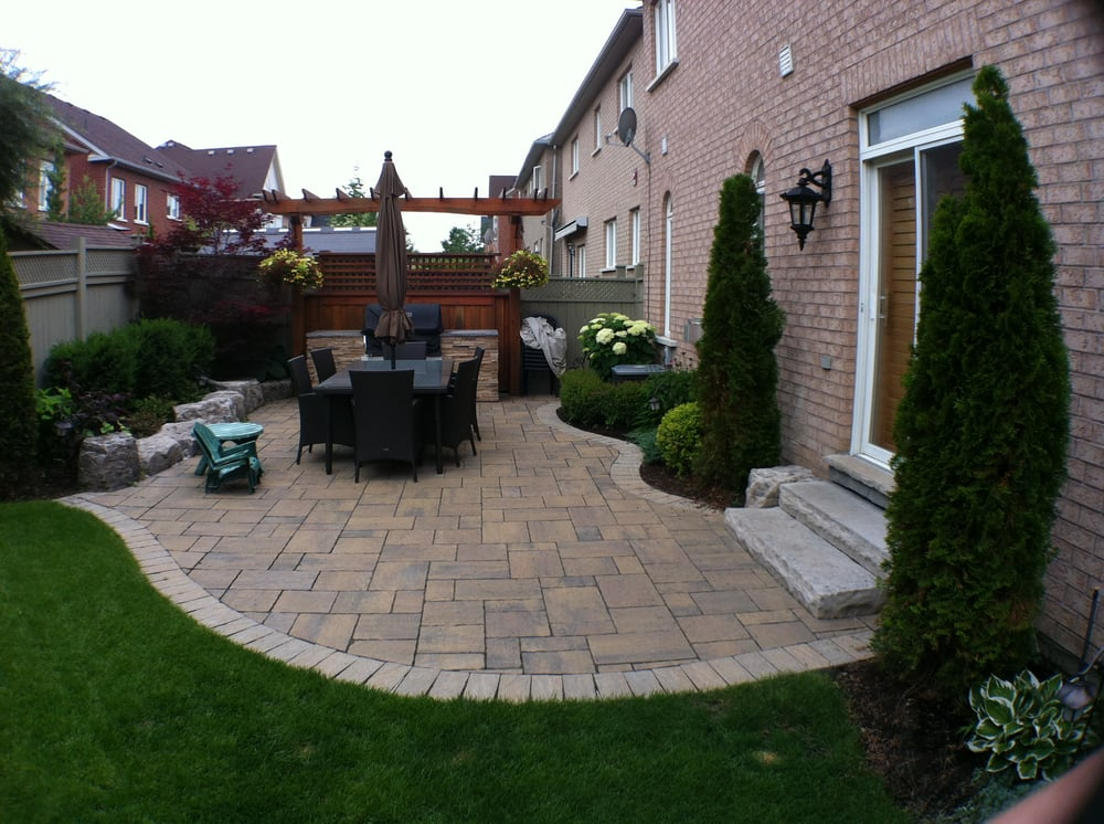 Working with a small backyard, we designed a comfortable patio complete with gardens and a gorgeous outdoor kitchen